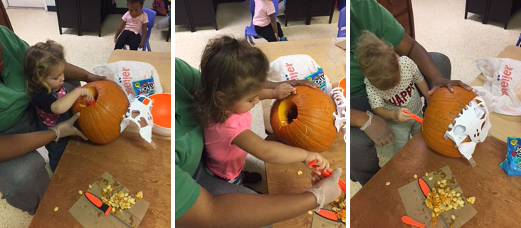 Young Preschoolers enjoying pumpkin carving
